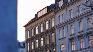 European building apartment facade at sunset. Evening feeling on the way home