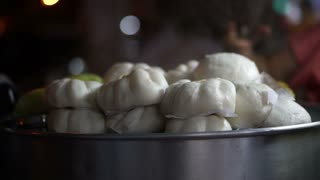 Fresh steamed Chinese pork bun selling in night local market of Asia
