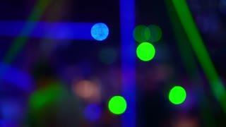 Fun light disco at nightclub blur laser light