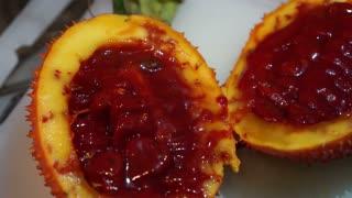 Gac fruit cut open, red healthy antioxidant food video