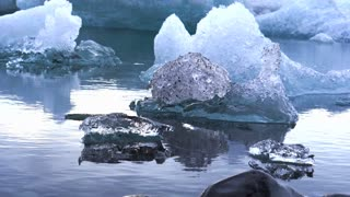 Glaciar 8 LagoonSmall and big pieces of iceberg floating in Jokulsarlon glacier lagoon. Global warming melting ice problem