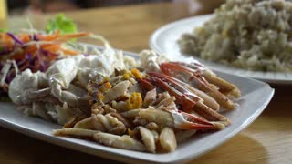 Hand eating blue crab meat. Thai style seafood meal