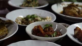 Hands eating set of Northern Thai food together video