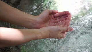 Hands Playing Waterfall clear water in Tropical forest Hd