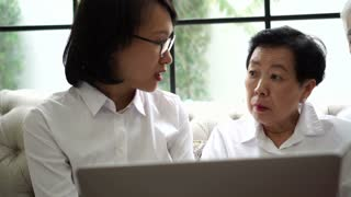 Health medical advise to Asian senior couple with computer laptop
