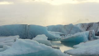 Jokulsarlon glacier lake in Iceland with ray of heaven sunlight shine down. Natural wonder landmark of Iceland