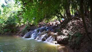Krabi, Thailand: May 2016 - Tourist playing at local waterfall in Krabi. Lush nature tropical forest and river