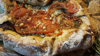 Lebanese style big flat bread baked and seasoning with different topping looks like pizza
