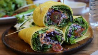 Pan shot of egg wrap and low carb salad diet 4K