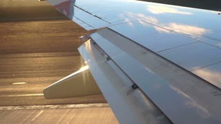 Plane taking off from runway when sunset slow motion shot