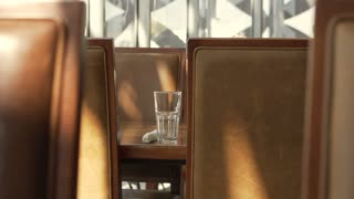 Restaurant elements concept, brown leather chair and glass next to window