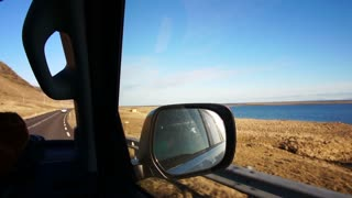 Road trip view POV point of view from inside car. Beautiful landscape of Iceland ocean