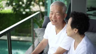 Senior couple relax talking, laughing together