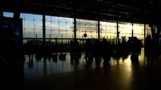 silhouettes of travellers in airport. Borderless world of business, communication and connection