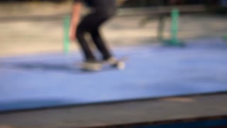 Skatboarder jump trick in blur slow motion