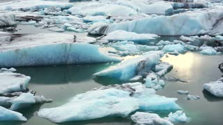 Small and big pieces of iceberg floating in Jokulsarlon glacier lagoon. Global warming melting ice problem