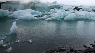 Timelapse blue icebergs floating and moving in Jokulsarlon glacial lagoon. Natural landmark of Iceland