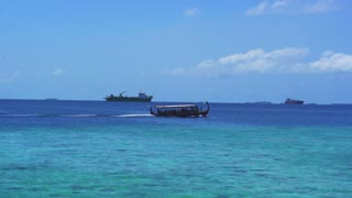 Traditional Maldives style boat sailing for tourist activities in Indian sea