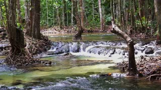 Tropical waterfall and emerald pond. Wild forest stream of Krabi Thailand
