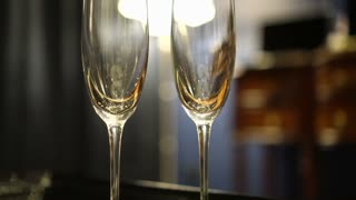 Two empty champagne glasses in luxury interior room for romantic anniversary