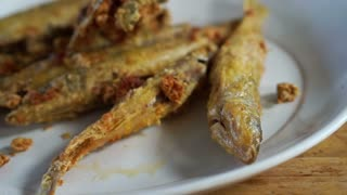 Whole small fish battered with herb and flour then deep fried to make it crispy. Best calcium source