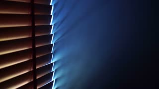 Wood blinds curtain block sunlight in to blue room wall