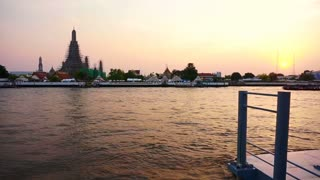 Wat Arun at Sunset, Temple of the Dawn in Bangkok, Thailand, Chao Phraya River. twilight moment of famous skyline