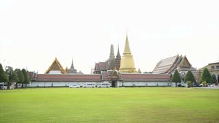 Wat Phra Kaew, Grand palace, Temple of the Emerald Buddha with sky and green lawn. Landmark of Bangkok,Thailand