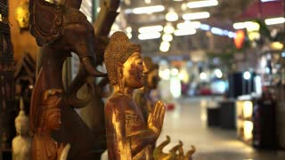 Wood art craft sculptures selling in night market of Thailand