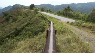 Walking along an oil pipeline running along an Andean ridgetop