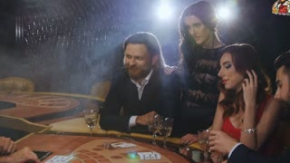 A group of young and beautiful people drinking champagne and playing blackjack