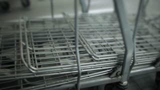 a lot of empty grocery carts at the supermarket