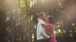 A young couple at sunset. couple in love in the forest