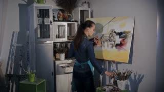 artist draws a brush on canvas
