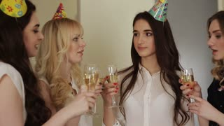 beautiful girl celebrating birthday with glasses of champagne