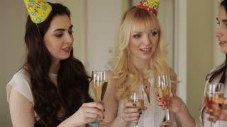 beautiful girls congratulate her friend a happy birthday