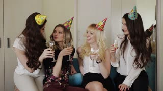 beautiful girls in a hotel arranged a party with glasses of champagne