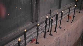 black candles burn smoothly. The decor in an abandoned building.