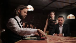 businessman with a prostitute playing casino blackjack