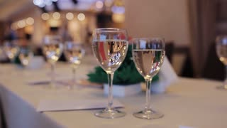 champagne glasses on the table. The waiter pours champagne into glasses. corporate event
