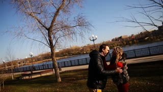 Couple having fun in a park. guy and a girl walking in the Park