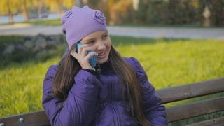 cute teen girl smiling talking on the phone. dental braces. slow-motion