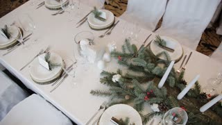 decor candles and fir branches on the table rustic