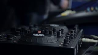 DJ work. Hands of a DJ on the mixer