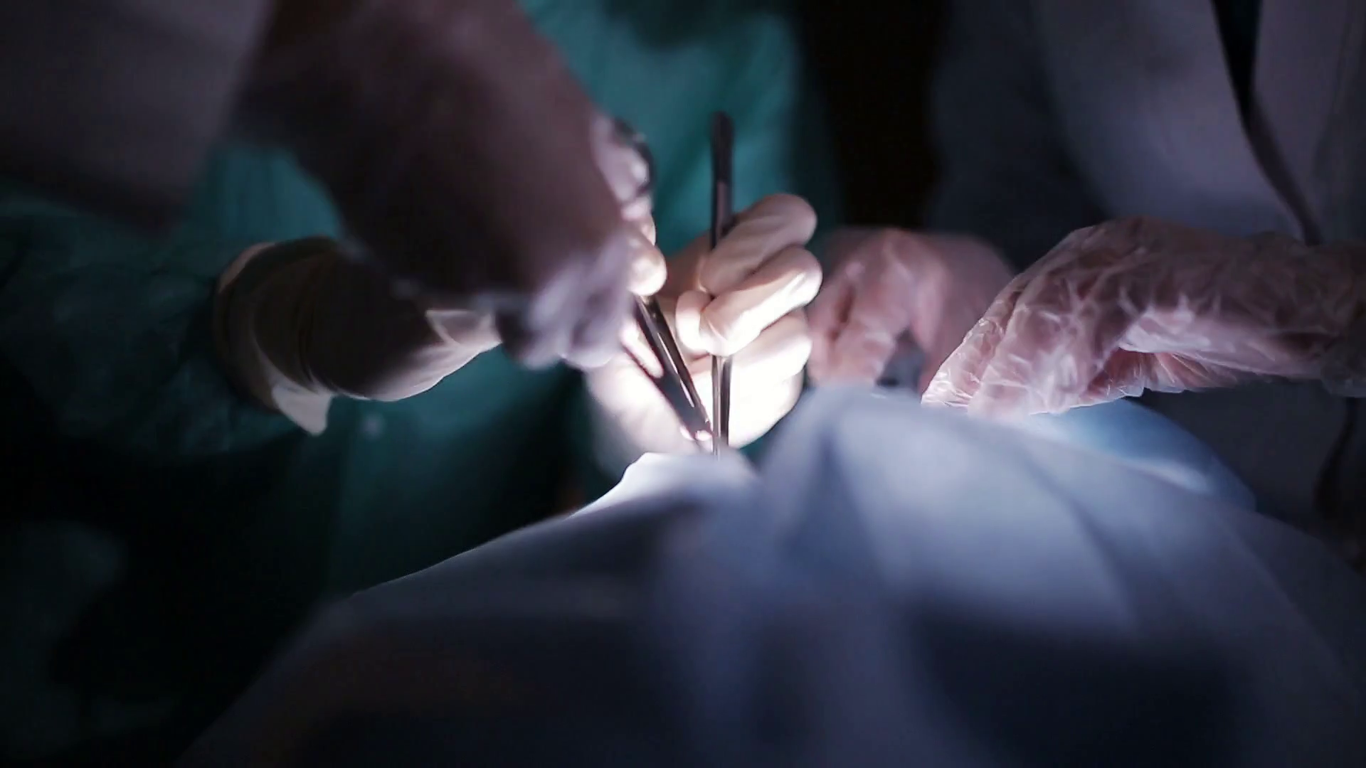 Surgeons Team Performing Operation In Hospital Theater