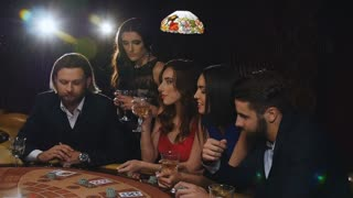 Elegant man and woman gambling at the casino. friends playing blackjack