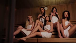 Five friends doing wellness in the sauna of a thermal bath