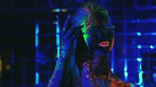 girl dancing in the ultraviolet light