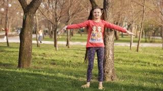 Girl doing morning exercises in the park