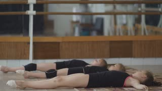 girl engaged in artistic gymnastics at the gym